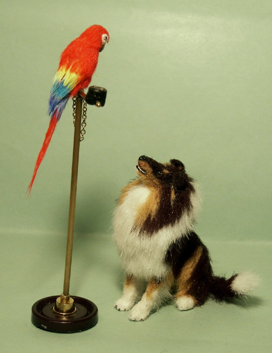 Rough collie and parrot on perch for the dolls house
